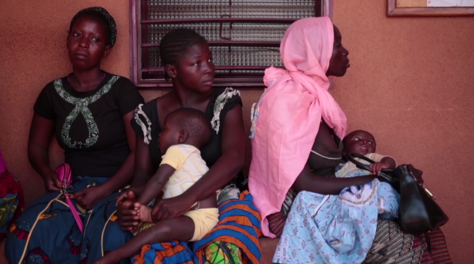 Women wait with their babies at a health centre in Burkina Faso, where ONE Africa Award finalist RAME works.  Photo: ONE
